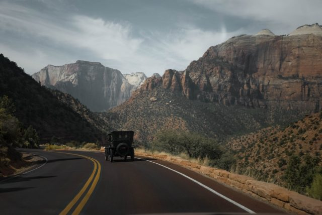 retro car on road in mountainous area