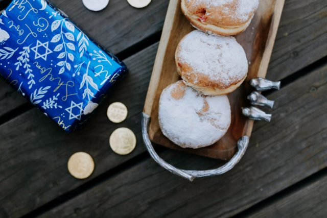 photo of doughnuts on top of wooden table