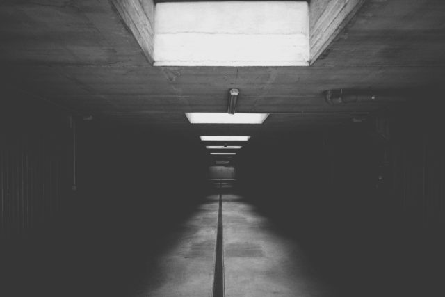 grayscale photo of concrete room