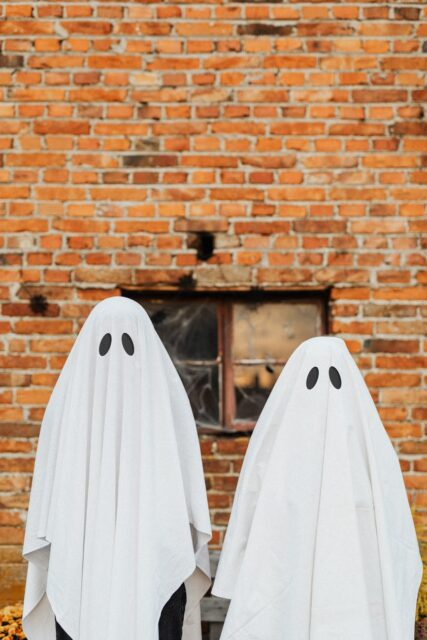 ghosts in front of a brick wall