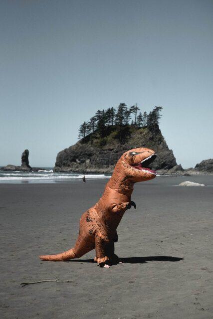 unrecognizable person in dinosaur costume