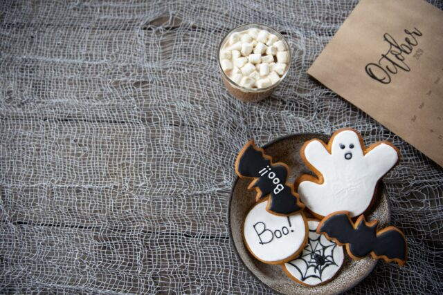 white and black halloween treats on round plate