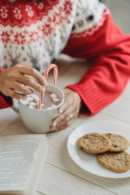 woman with cup of coffee with marshmallows