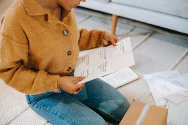 woman in soft stylish cardigan checking information in chart