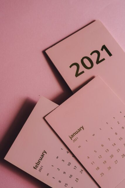 set of paper calendars with months on pink background