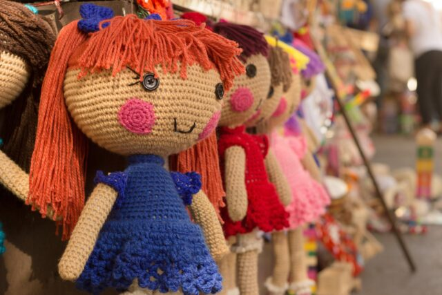 brown purple red knitted doll